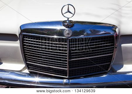 Tel Aviv, Israel, June 12, 2016: Vintage Mercedes front grill with emblem. Mercedes-Benz is a global automobile manufacturer and a division of the German company Daimler AG.