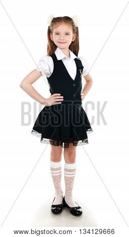 Portrait of smiling schoolgirl in uniform isolated on a white background
