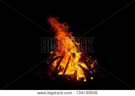 Image of a large campfire in a costa rica hippie camp at night