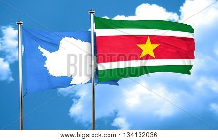 antarctica flag with Suriname flag, 3D rendering