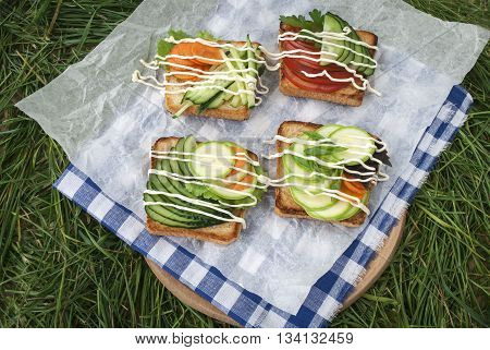 sandwiches with vegetables, fresh tomatoes, cucumbers and zucchini.