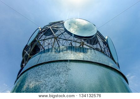 Zinc plate cylinder with round backlit mirrors