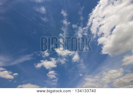 Dramatic blue sky with puffy white clouds in bright clear sunny day