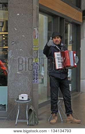 Padua Italy - November 25 2015: street musician is showing a thumb to someone in Padua Italy