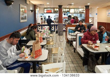 NEW YORK - CIRCA MARCH, 2016: interior of McDonald's restaurant. McDonald's is the world's largest chain of hamburger fast food restaurants, founded in the United States.