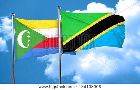 Comoros flag with Tanzania flag, 3D rendering