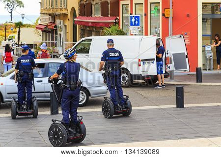 NICE, FRANCE - MAY 19, 2015: It patrols the city police on modern means of transport Segway.