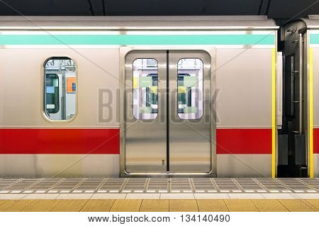 Generic underground metro train in Tokyo Prefecture of Japan - Urban public transportation concept with subway vehicle in japanese capital city
