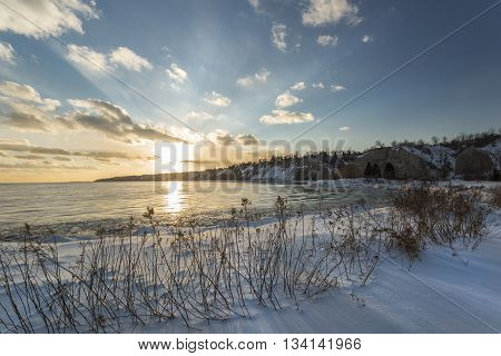A sunset over the bluffs overlooking Lake Ontario in winter.