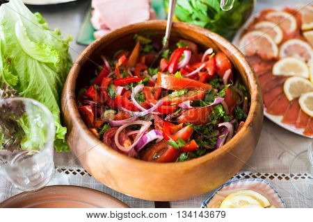 Salad From Tomatoes, Cucumbers On Served Table