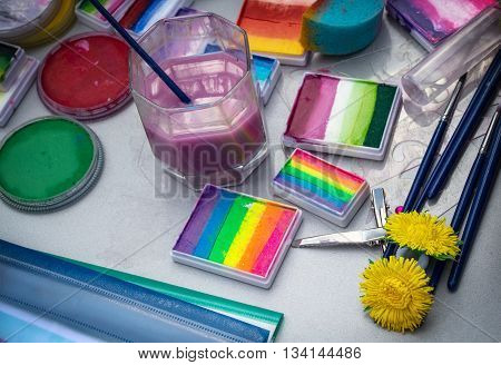 Tools: paint brushes liquid - Aqua make-up body art