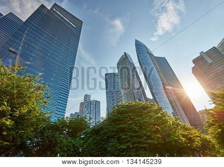Skyscrapers in central business district of Singapore. Lens flare effect