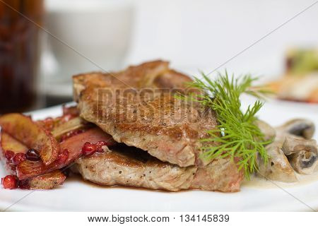Meat mushroom and red cowberry sauce with potatos