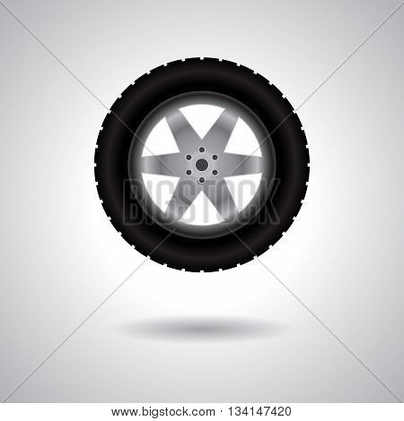 Big truck wheel with tire track isolated on gray background with shadow