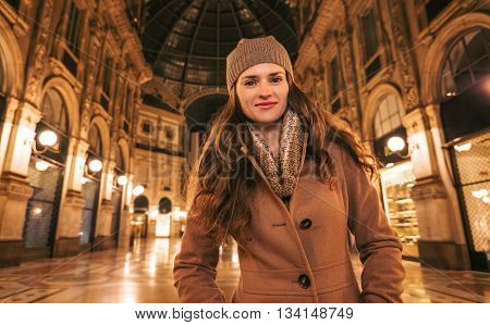 Happy Young Woman Standing In Galleria Vittorio Emanuele Ii