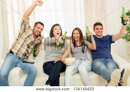 Friends Watching A Tv In The Home