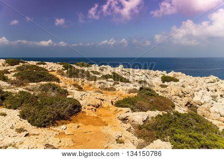 Seascape with rocks shore of Mediterranean Sea. Coast of Cyprus Ayia Napa.