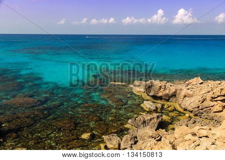 Seascape with azure sea and rocks coast of the Mediterranean Sea at sunny summer day. Coast of Cyprus Ayia Napa.