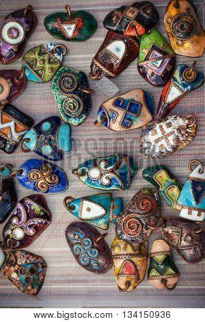 Various trinkets: talisman badge pendantpagan symbol sign.