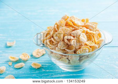 cornflakes on blue wooden table at morning