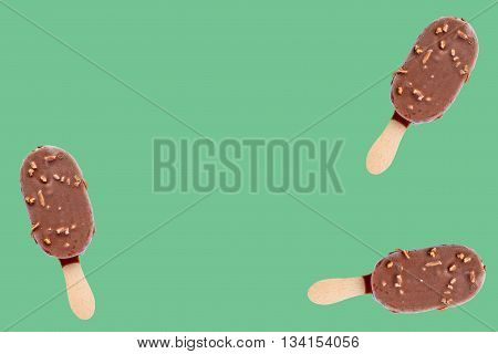 three isolated ice creams on green background with free space