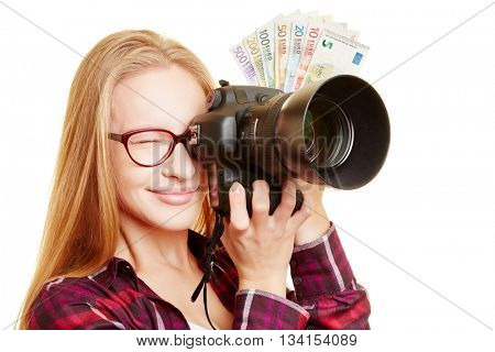 Young woman as photographer with Euro money and digital camera