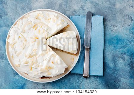 Three milk cake, tres leches cake with coconut. Traditional dessert of Latin America Top view Copy space.