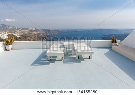 View from the terrace in the town Fira. Picturesque landscape with the sea and the caldera.