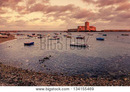 Sicily, Italy: fishermen's harbor in Trapani in the sunset
