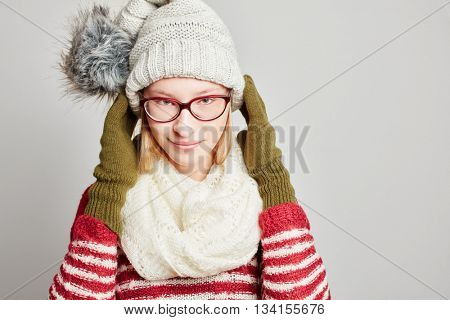 Young atractive woman with a scarf and a cap in winter