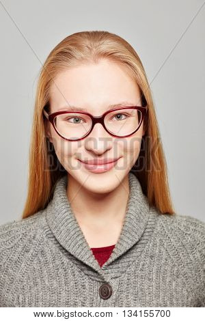 Head shot of a young blond woman wearing glasses for a job application
