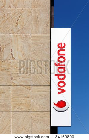 Kiel, Germany - June 4, 2016: Vodafone sign on a wall of a store. Vodafone is a British multinational telecommunications company with its headquarters in London, Great Britain