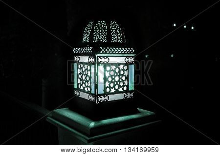 The night lamp lights the dark street