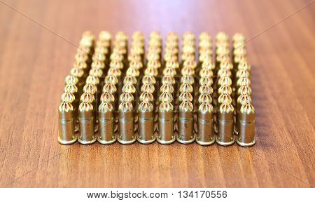 Many idle construction ammunition bullets on the table