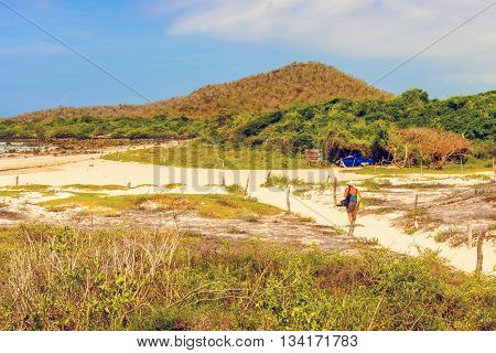 Santa Cruz Island Galapagos Ecuador - April 11 2016: Tourists visiting the el Garrapatero beach on Santa Cruz island