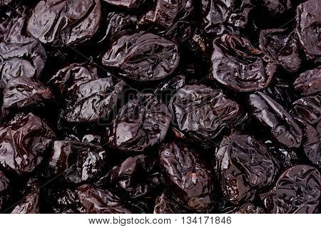 Background texture of several juicy dried plums.