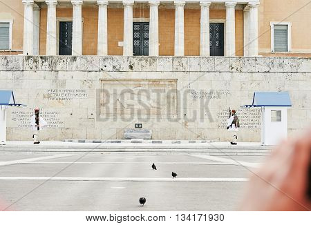Athens Greece - March 27 2016: The changing of the honor Evzones guards ceremony in front of the Tomb of the Unknown Soldier at the Parliament Building in Syntagma Square Athens Greece.