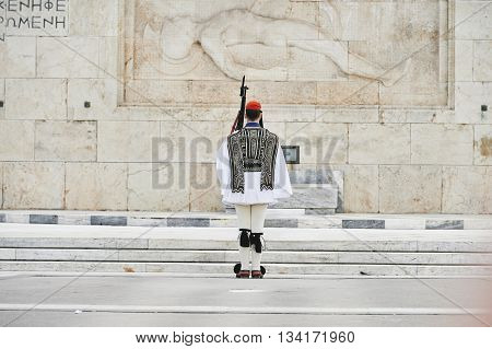 Rear view of honor Evzones guard in front of the Tomb of the Unknown Soldier at the Parliament Building in Syntagma Square Athens Greece.