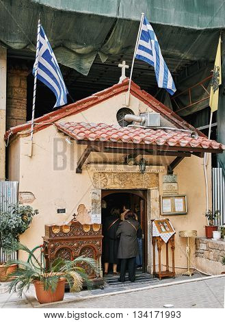 Athens Greece - March 27 2016: People enetering in small church in the center of Athens for the morning pray