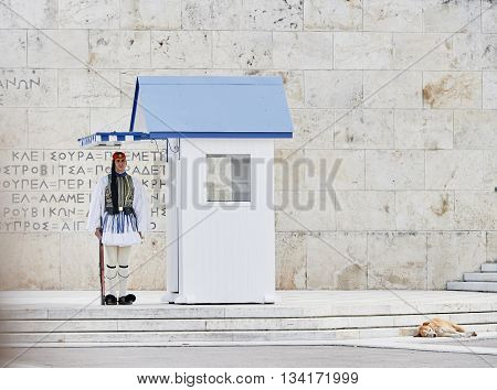 Athens Greece - March 27 2016: Still honor Evzones guards ceremony in front of the Tomb of the Unknown Soldier at the Parliament Building in Syntagma Square Athens Greece.