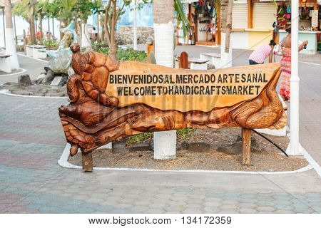 Puerto Ayora Galapagos Ecuador - April 6 2016: Welcome sign at the entrance to handicrafts market in Puerto Ayora on Santa Cruz Island in Galapagos