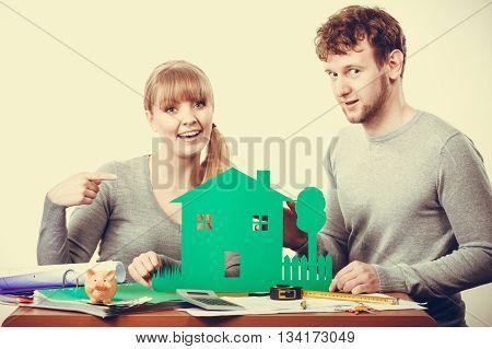 Smiling Couple Preparing Their Future.