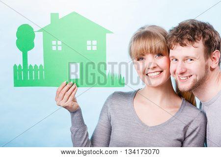 Couple Holding House Cutout.