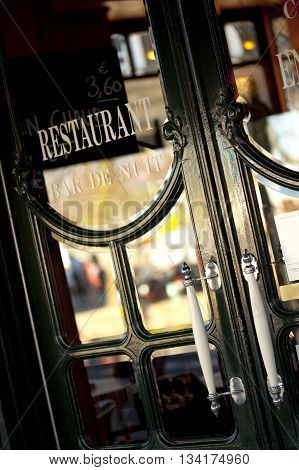 Vintage wooden door of a French bistro
