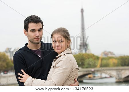 Young Couple In Paris Hugging