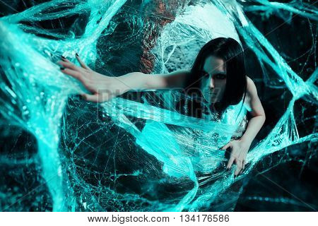 Woman sitting in big cocoon. Creative photoshoot