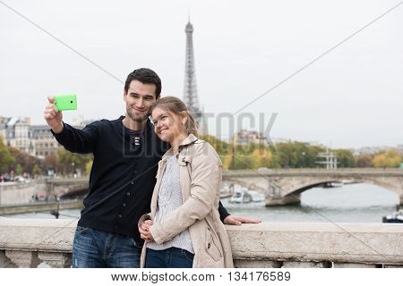 Young Couple In Paris Making Selfie