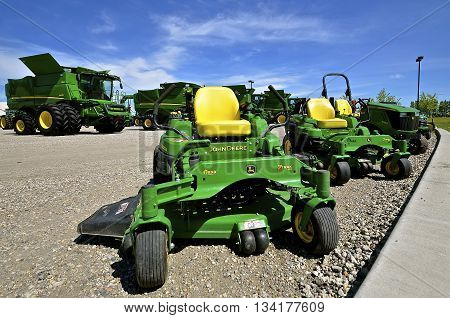 MOORHEAD, MINNESOTA, June 6, 2016: The new combines and riding lawn mowers are products of John Deere Co, an American corporation that manufactures agricultural, construction, forestry machinery, diesel engines, and drivetrains.