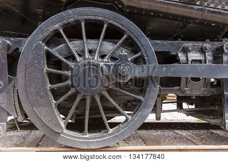 The wheel of an old railroad steam locomotive.