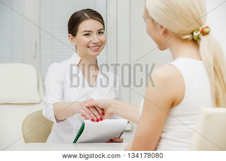 Doctor talking to her female patient at office